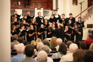 Monek leads the MC Concert Choir in the 2015 Spring Concert. Photo courtesy of Marietta College.